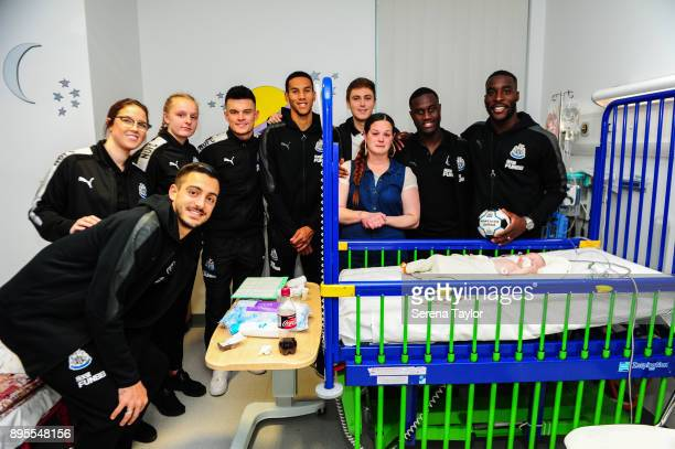 Newcastle Players seen LR Joselu Siobhan Jones Ellie Mark Dan Ward Isaac Hayden Liam Smith Henri Saivet and Massadio Haidara pose for a photo with a...