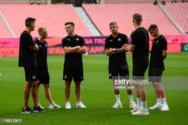 Newcastle Players seen LR Kelland Watts Matthew Longstaff Owen Bailey Elias Sorensen Nathan Harker and Tom Allan stand on the pitch during the...