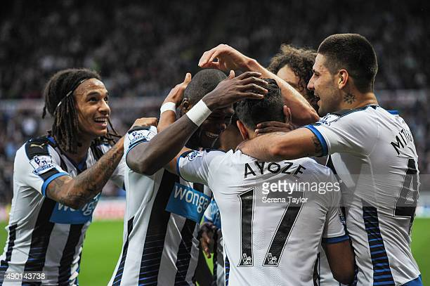 Newcastle players seen LR Kevin Mbabu Chancel Mbemba Fabricio Coloccini and Aleksandar Mitrovic celebrate with Ayoze Perez after he scored the...
