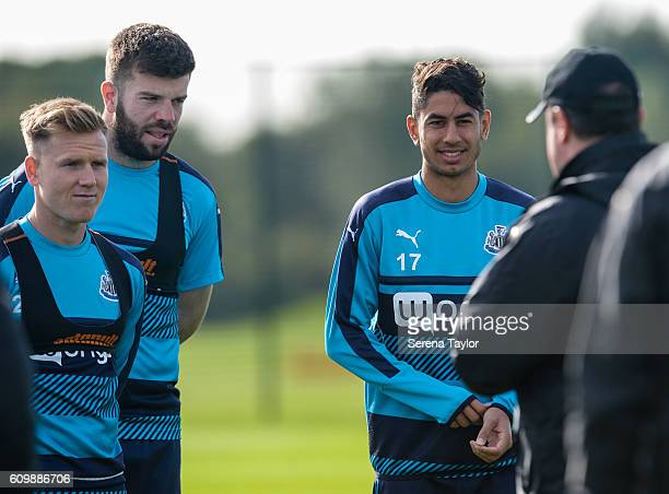 Newcastle players seen LR Matt Ritchie Grant Hanley and Ayoze Perez speak to Manager Rafael Benitez during Newcastle United Training Session at The...