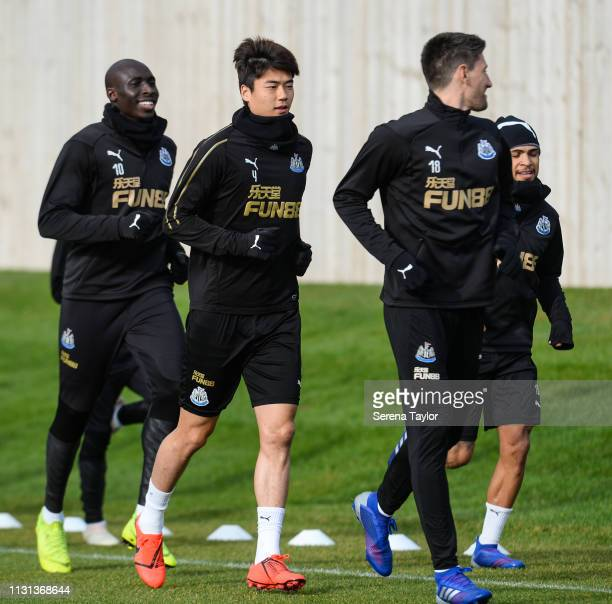 Newcastle players seen LR Mohamed Diame Ki SungYueng Federico Fernandez and DeAndre Yedlin warm upduring the Newcastle United Training Session at the...