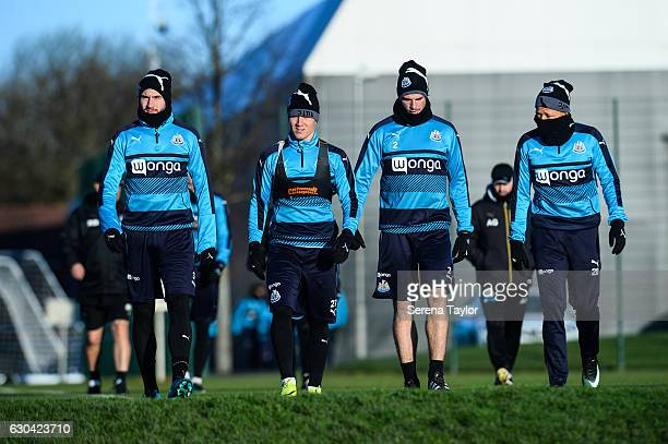 Newcastle Players seen LR Paul Dummett Matt Ritchie Ciaran Clark and Dwight Gayle walk outside to the training pitch during Newcastle United Training...