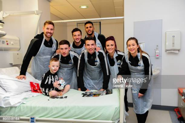 Newcastle Players seen LR Rob Elliot Callum Roberts Jamie Sterry Dan Barlaser Jamaal Lascelles Brooke Cochrane and Emily Tait pose for a photo with a...