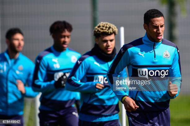 Newcastle players seen RL Isaac Hayden DeAndre Yedlin Rolando Aarons and Achraf Lazaar warm up during the Newcastle United Training Session at The...