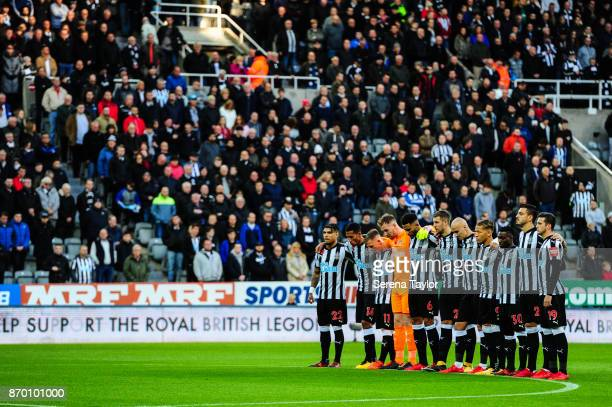 Newcastle players stand for a minutes silence during the Premier League match between Newcastle United and AFC Bournemouth at StJames' Park on...