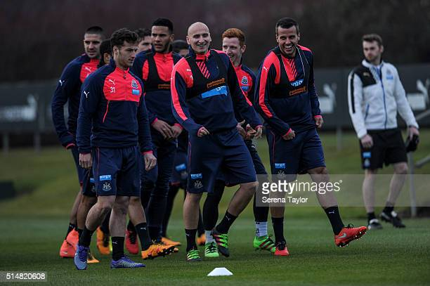 Newcastle Players Steven Taylor and Jonjo Shelvey laugh during the Newcastle United Training session at The Newcastle United Training Centre on March...