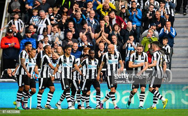 Newcastle players walk back to the centre circle after Dwight Gayle scores the second goal during the Sky Bet Championship Match between Newcastle...