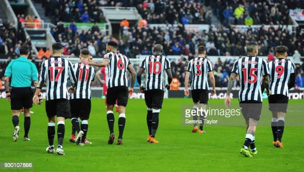 Newcastle players walk back to the centre circle after Matt Ritchie scores Newcastle's third goal during the Premier League match between Newcastle...