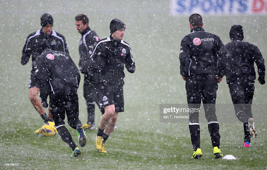 Newcastle players warm up during a snowy Newcastle United training session at the Little Benton Training Ground on January 14, 2013 in Newcastle upon Tyne, England.