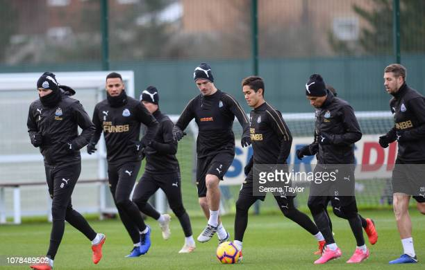 Newcastle players warm up during the Newcastle United Training Session at the Newcastle United Training Centre on December 07 2018 in Newcastle upon...
