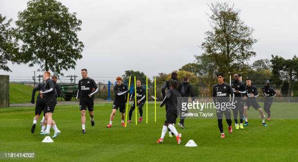 Newcastle players warm up during the Newcastle United Training Session at the Newcastle United Training Centre on October 16 2019 in Newcastle upon...