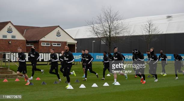 Newcastle Players warm up during the Newcastle United Training Session at the Newcastle United Training Centre on January 13 2020 in Newcastle upon...