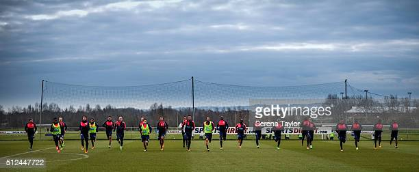 Newcastle Players warm up during the Newcastle United Training session at The Newcastle United Training Centre on February 26 in Newcastle upon Tyne,...