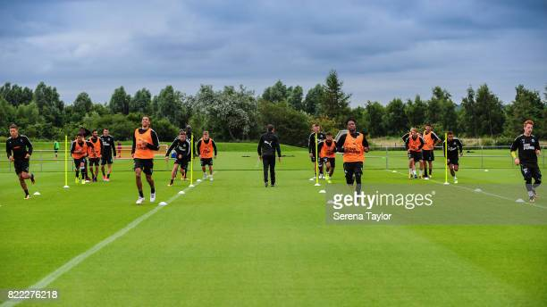 Newcastle players warm up during the Newcastle United Training session at the Newcastle United Training ground on July 25 in Newcastle upon Tyne,...