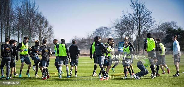 Newcastle players warm up outside during a Newcastle United Training session at The Newcastle United Training Centre on March 19 in Newcastle upon...