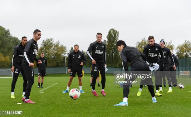 Newcastle players warm up with a game of Boxes during the Newcastle United Training Session at the Newcastle United Training Centre on October 16...