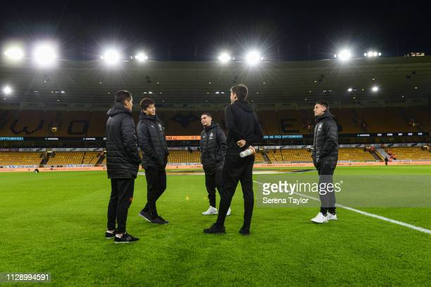 Newcastle players Yoshinori Muto Ki SungYueng Miguel Almiron Federico Fernandez and Antonio Barreca stand on the pitch before kick off of the Premier...