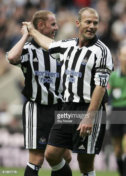 Newcastle striker Alan Shearer is congratulated by Nicky Butt after scoring the second goal during the FA Barclays Premiership match between...