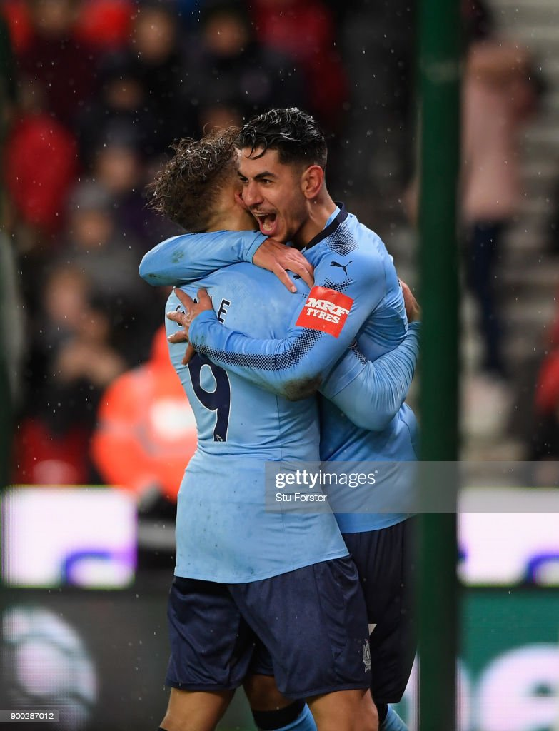 Newcastle striker Ayoze Perez (r) celebrates with Dwight Gayle after scoring the winning goal during the Premier League match between Stoke City and Newcastle United at Bet365 Stadium on January 1, 2018 in Stoke on Trent, England.