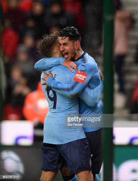 Newcastle striker Ayoze Perez celebrates with Dwight Gayle after scoring the winning goal during the Premier League match between Stoke City and...