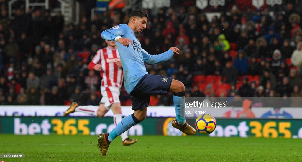Newcastle striker Ayoze Perez scores the winning goal during the Premier League match between Stoke City and Newcastle United at Bet365 Stadium on January 1, 2018 in Stoke on Trent, England.