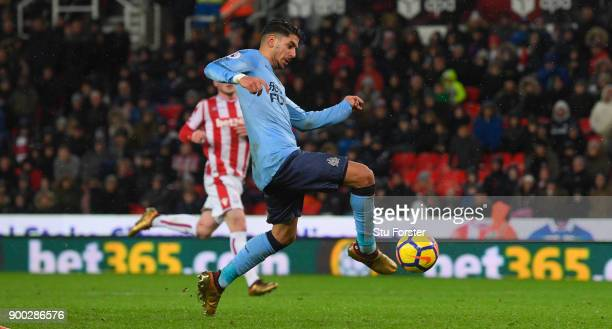Newcastle striker Ayoze Perez scores the winning goal during the Premier League match between Stoke City and Newcastle United at Bet365 Stadium on...