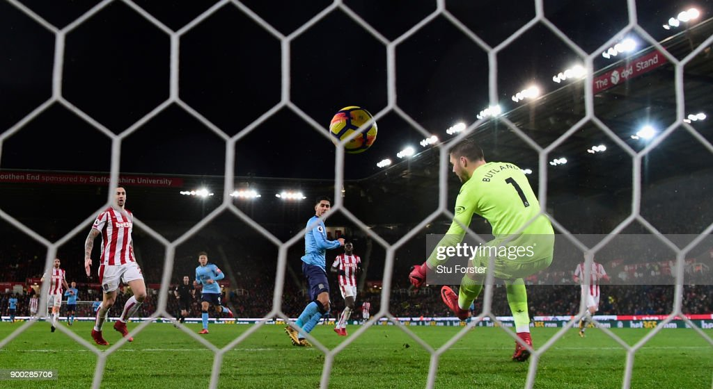 Newcastle striker Ayoze Perez scores the winning goal past Jack Butland during the Premier League match between Stoke City and Newcastle United at Bet365 Stadium on January 1, 2018 in Stoke on Trent, England.