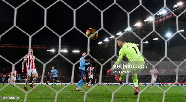Newcastle striker Ayoze Perez scores the winning goal past Jack Butland during the Premier League match between Stoke City and Newcastle United at...