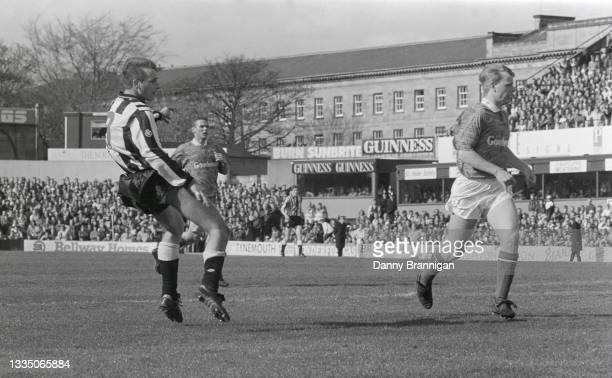 Newcastle striker David Kelly shoots to score the winning goal as Pompey full back Andy Awford looks on, the goal and the subsequent win is believed...