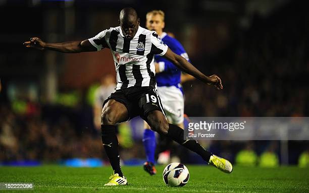 Newcastle striker Demba Ba scores the first Newcastle goal during the Premier League match between Everton and Newcastle United at Goodison Park on...