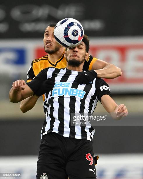 Newcastle striker Joelinton is challenged by Romain Saiss during the Premier League match between Newcastle United and Wolverhampton Wanderers at St....