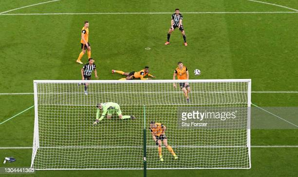 Newcastle striker Joelinton reacts after his shot is cleared on the line by Wolves defender Romain Saiss and goalkeeper Rui Patricio during the...