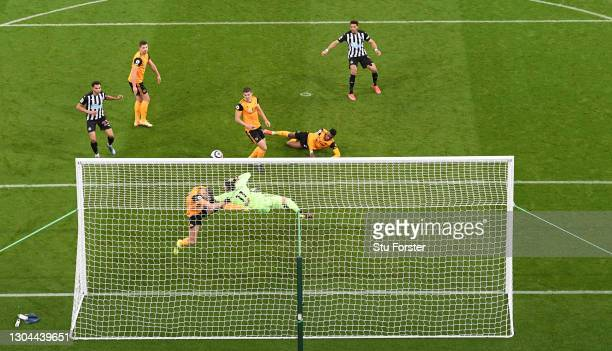 Newcastle striker Joelinton sees his shot cleared on the line by Wolves defender Romain Saiss and goalkeeper Rui Patricio during the Premier League...