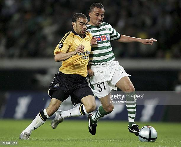 Newcastle striker Kieron Dyer beats Rogerio to the ball during the UEFA Cup Quarter Final second leg match between Sporting Lisbon and Newcastle...