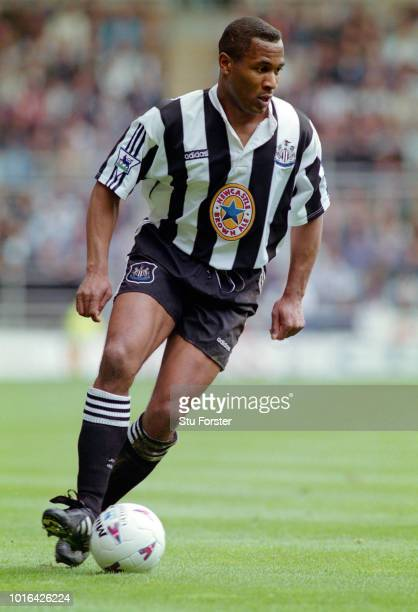 Newcastle striker Les Ferdinand in action wearing the adidas blue star strip during a Premiership match against Derby County at St James' Park on...
