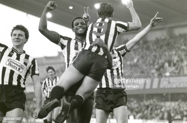 Newcastle striker Paul Goddard is held aloft by Tony Cunningham as Peter Jackson and Glenn Roeder join in the celebrations after Goddard had scored...