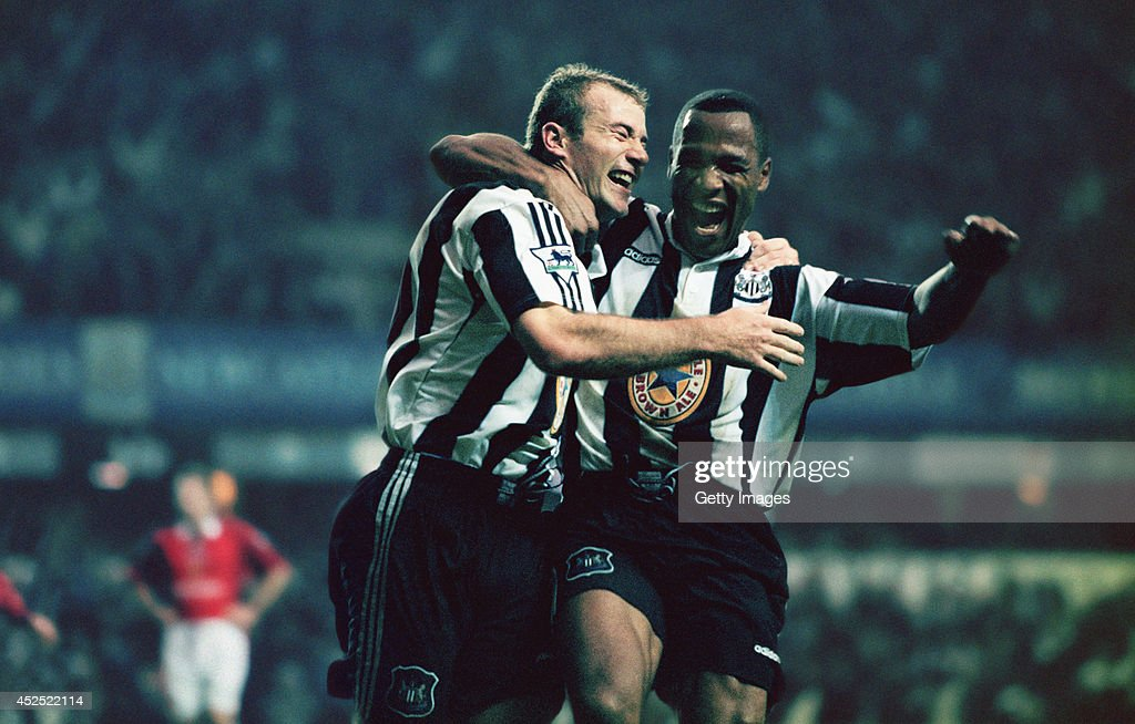 Newcastle strikers Alan Shearer (l) and Les Ferdinand celebrate a goal during the Premiership match between Newcastle United and Manchester United at St Jame's Park on October 20, 1996 in Newcastle, England. Newcastle won the game 5-0.