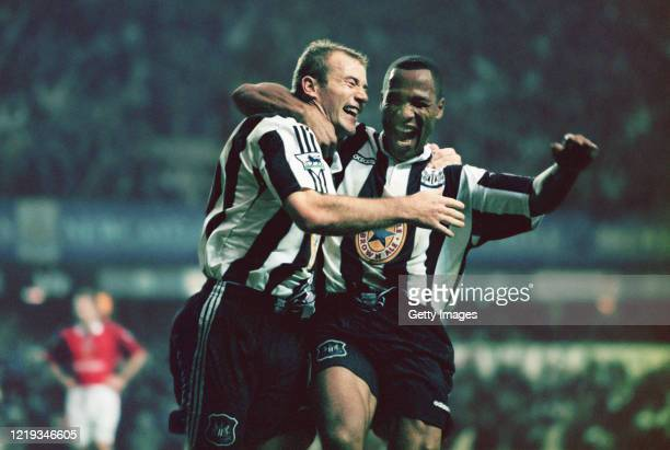 Newcastle strikers Alan Shearer and Les Ferdinand celebrate the fourth goal scored by Shearer during the Premier League match between Newcastle...