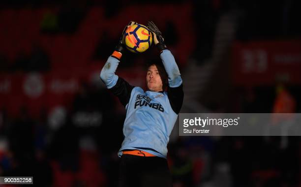 Newcastle sub goalkeeper Freddie Woodman in action during the warm up befored the Premier League match between Stoke City and Newcastle United at...
