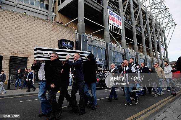 Newcastle supporters carry a 'St James' Park coffin around the ground before the Barclays Premier League match between Newcastle United and...
