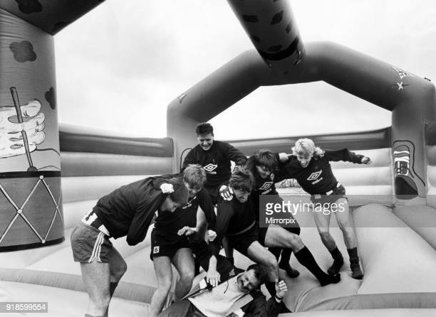 Newcastle United 1986 Pre Season Players take time out on a inflatable bouncing castle at their Benwell training ground to help publicise Bounce Aid...