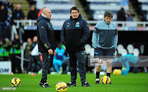 Newcastle United caretaker coach John Carver chats with assistant Steve Stone as coach Peter Beardsley looks on before the Barclays Premier League...