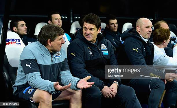 Newcastle United caretaker coach John Carver chats with coach Peter Beardsley as assistant Steve Stone looks on before the Barclays Premier League...