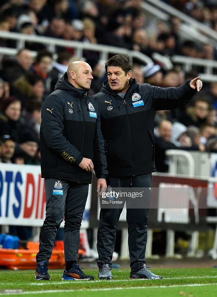 Newcastle United caretaker coach John Carver (r) makes a point with assistant Steve Stone during the Barclays Premier League match between Newcastle United and Burnley at St James' Park on January 1, 2015 in Newcastle upon Tyne, England.