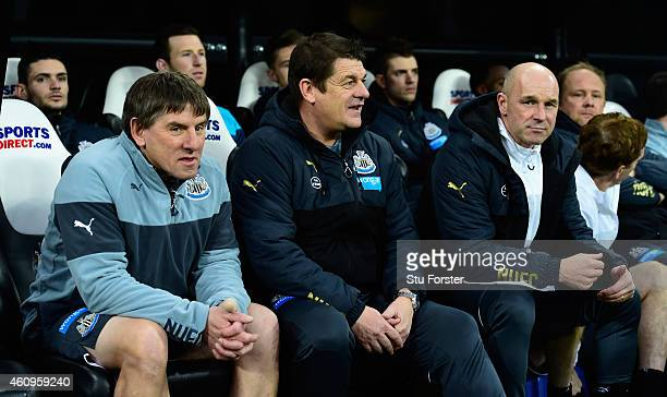 Newcastle United caretaker manager John Carver chats with coach Peter Beardsley as assistant Steve Stone looks on before the Barclays Premier League...