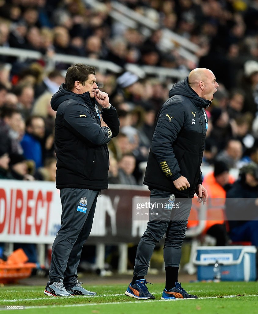 Newcastle United caretaker manager John Carver (r) looks on as assistant Steve Stone barks out orders during the Barclays Premier League match between Newcastle United and Burnley at St James' Park on January 1, 2015 in Newcastle upon Tyne, England.