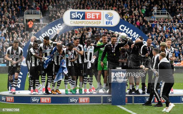 Newcastle United celebrate after winning the Sky Bet Championship match between Newcastle United and Barnsley at St James' Park on May 7 2017 in...