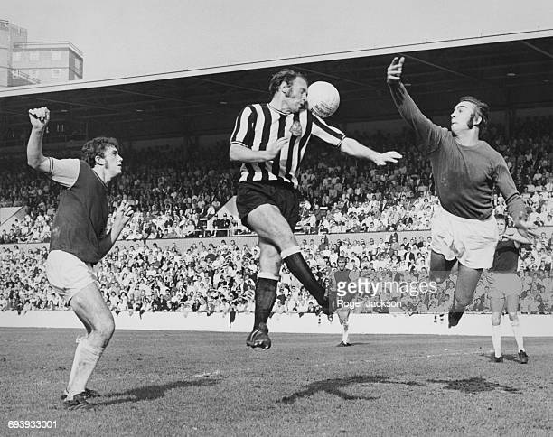 Newcastle United centre forward Bryan Robson jumps to head the ball past West Ham United goalkeeper Peter Grotier to score as West Ham midfielder...