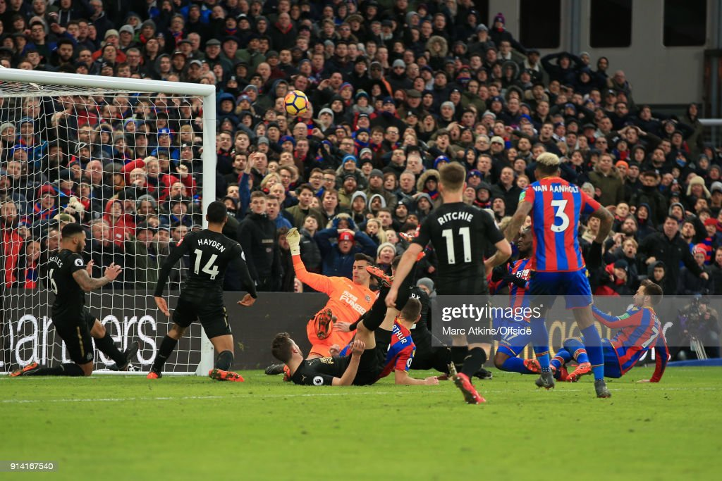 Newcastle United clear the ball after a late scramble in the penalty area during the Premier League match between Crystal Palace and Newcastle United at Selhurst Park on February 4, 2018 in London, England.