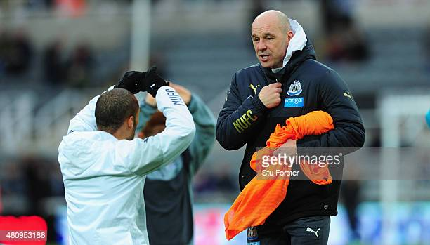 Newcastle United coach Steve Stone chats with Yoan Gouffran before the Barclays Premier League match between Newcastle United and Burnley at St...